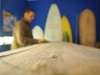 Keith making a surfboard out of gathered Agave wood.